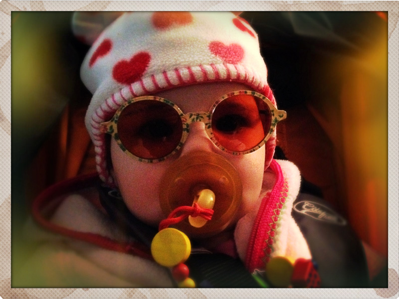 Cute baby with sunglasses and pacifier