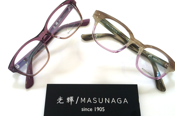 Two pair of Masunaga Optical frames, in rich hues of browns and blues