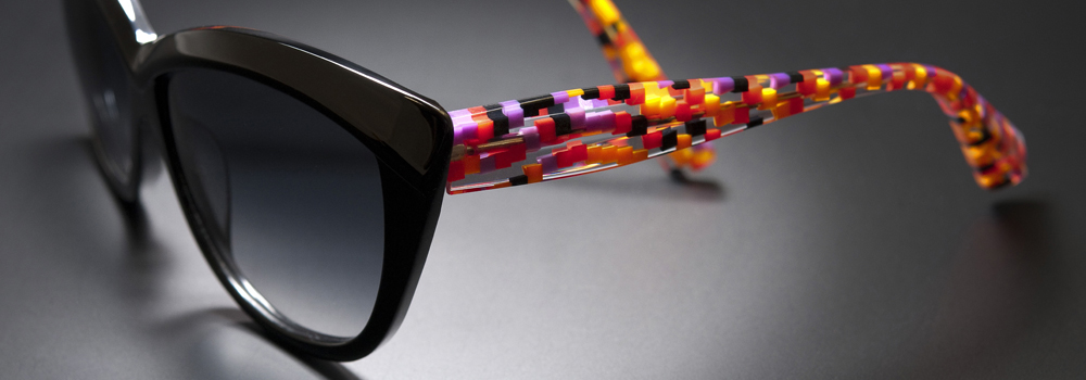 Alain Mikli Black Sunglasses with Checkered temples.