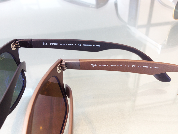 Side view of two of the new skinnier Wayfarer Liteforce shown in black and gold