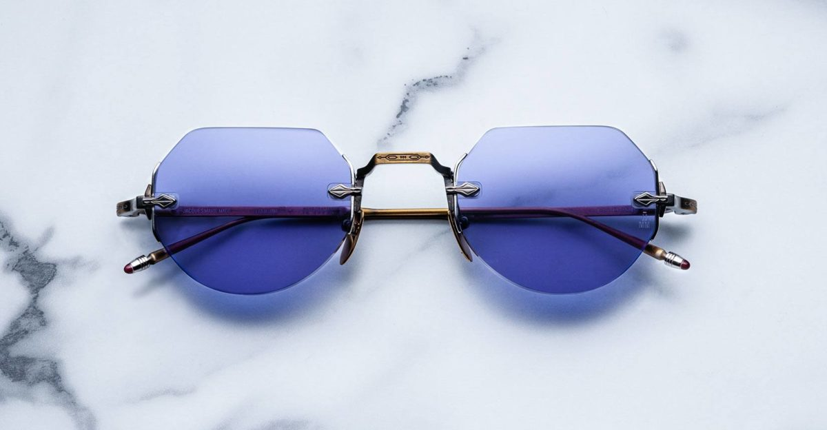 Jacques Marie Mage Cody style rimless sunglasses in Bronze colorway with purple lenses