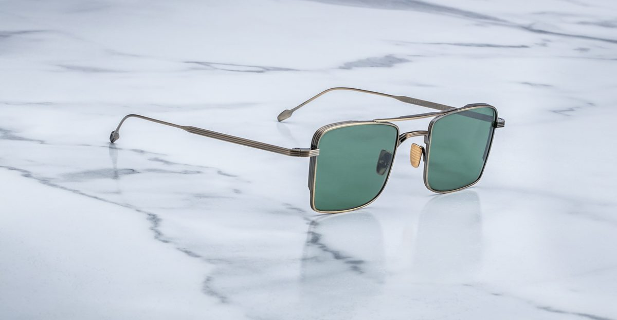 Angled view of the Jacques Marie Mage Altamont style sunglasses in Gold Antique