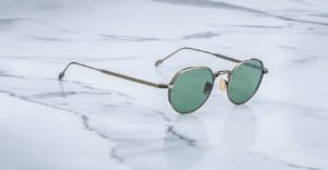 Angled view of the Jacques Marie Mage Fontana style sunglasses in colorway Gold Antique