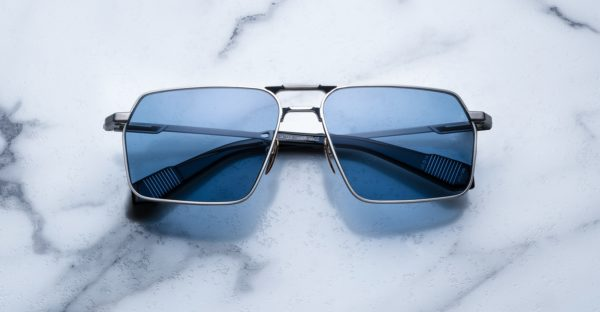 Angled view of the Jacques Marie Mage GT style sunglasses in colorway Antique