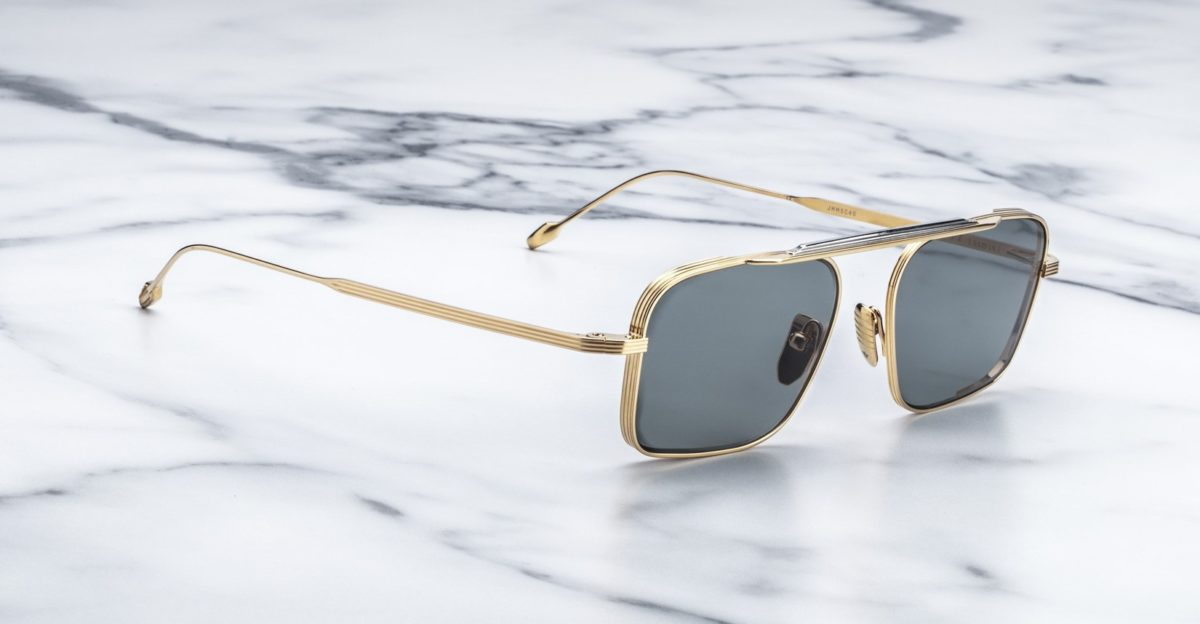 Angled view of the Jacques Marie Mage Scarpa Sunglasses in Gold