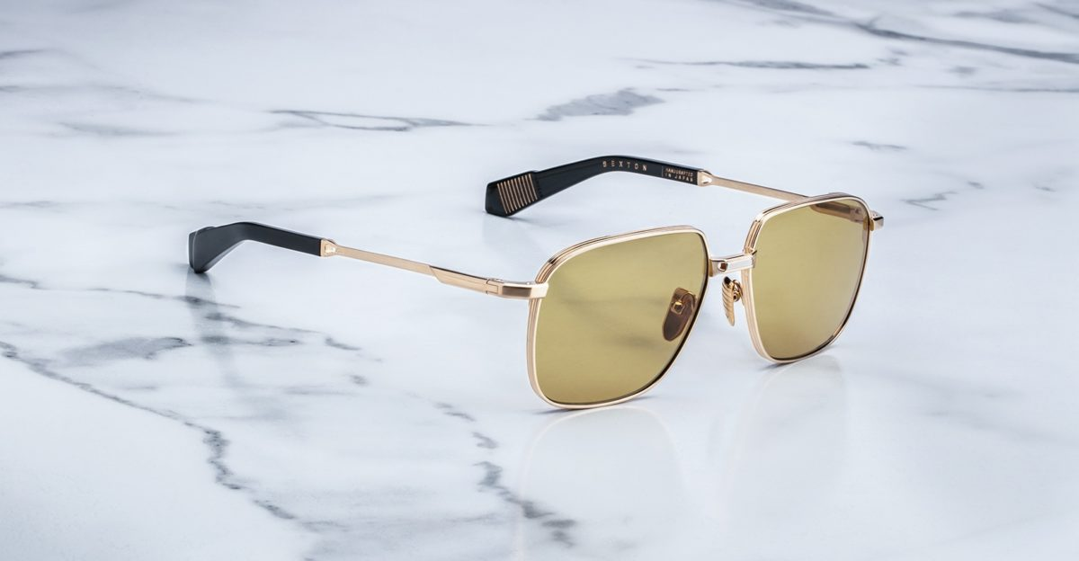 Angled view of the Jacques Marie Mage Sexton style sunglasses in Gold